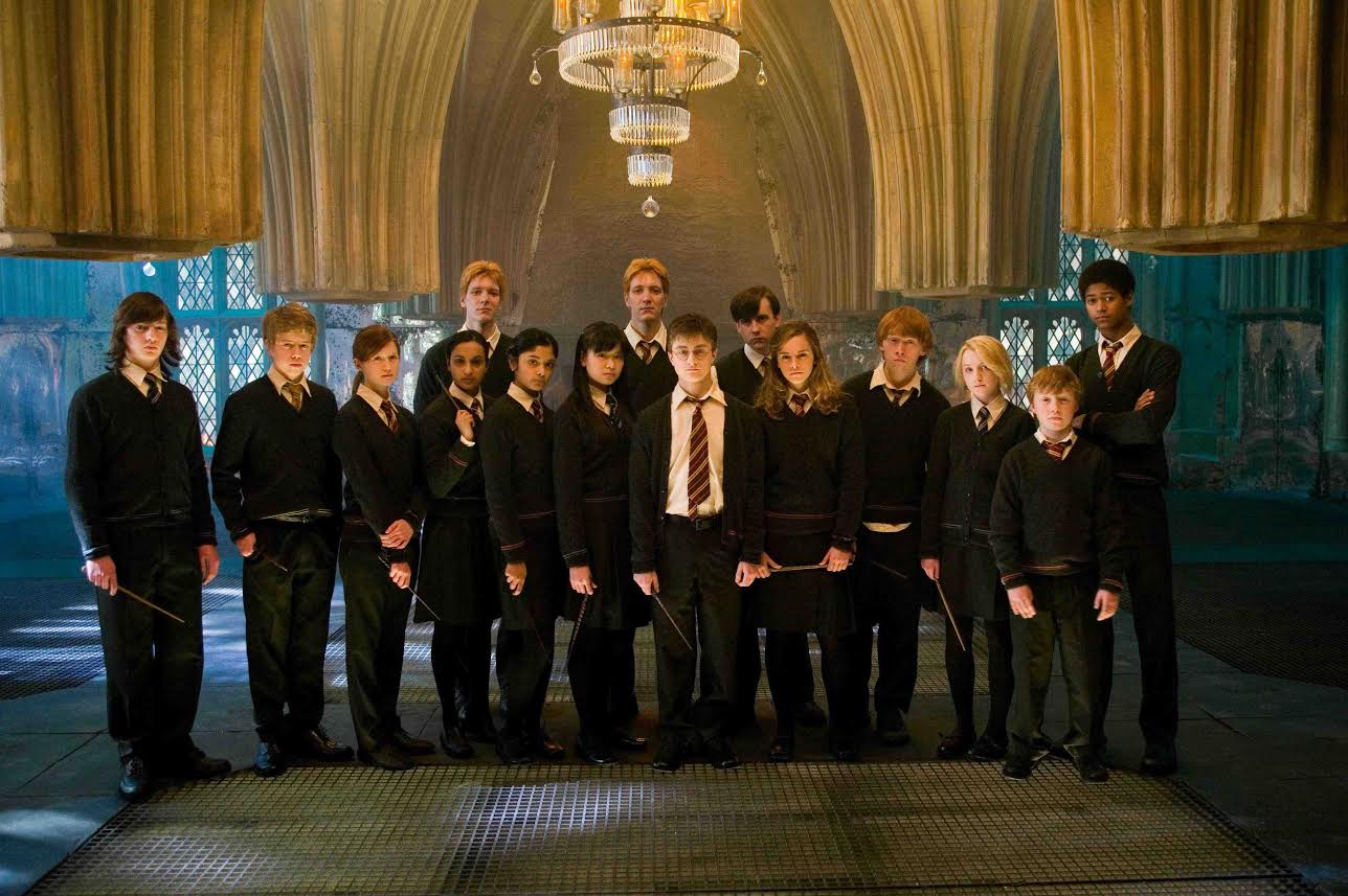 "(L-r) RYAN NELSON as Slightly Creepy Boy, NICK SHRIM as Somewhat Doubtful Boy, BONNIE WRIGHT as Ginny Weasley, SHEFALI CHOWDHURY as Parvati Patil, OLIVER PHELPS as George Weasley, AFSHAN AZAD as Padma Patil, KATIE LEUNG as Cho Chang, JAMES PHELPS as Fred Weasley, DANIEL RADCLIFFE as Harry Potter, MATTHEW LEWIS as Neville Longbottom, EMMA WATSON as Hermione Granger, RUPERT GRINT as Ron Weasley, EVANNA LYNCH as Luna Lovegood, WILLIAM MELLING as Nigel and ALFRED ENOCH as Dean Thomas in Warner Bros. Pictures' fantasy ""Harry Potter and the Order of the Phoenix.""PHOTOGRAPHS TO BE USED SOLELY FOR ADVERTISING, PROMOTION, PUBLICITY OR REVIEWS OF THIS SPECIFIC MOTION PICTURE AND TO REMAIN THE PROPERTY OF THE STUDIO. NOT FOR SALE OR REDISTRIBUTION"