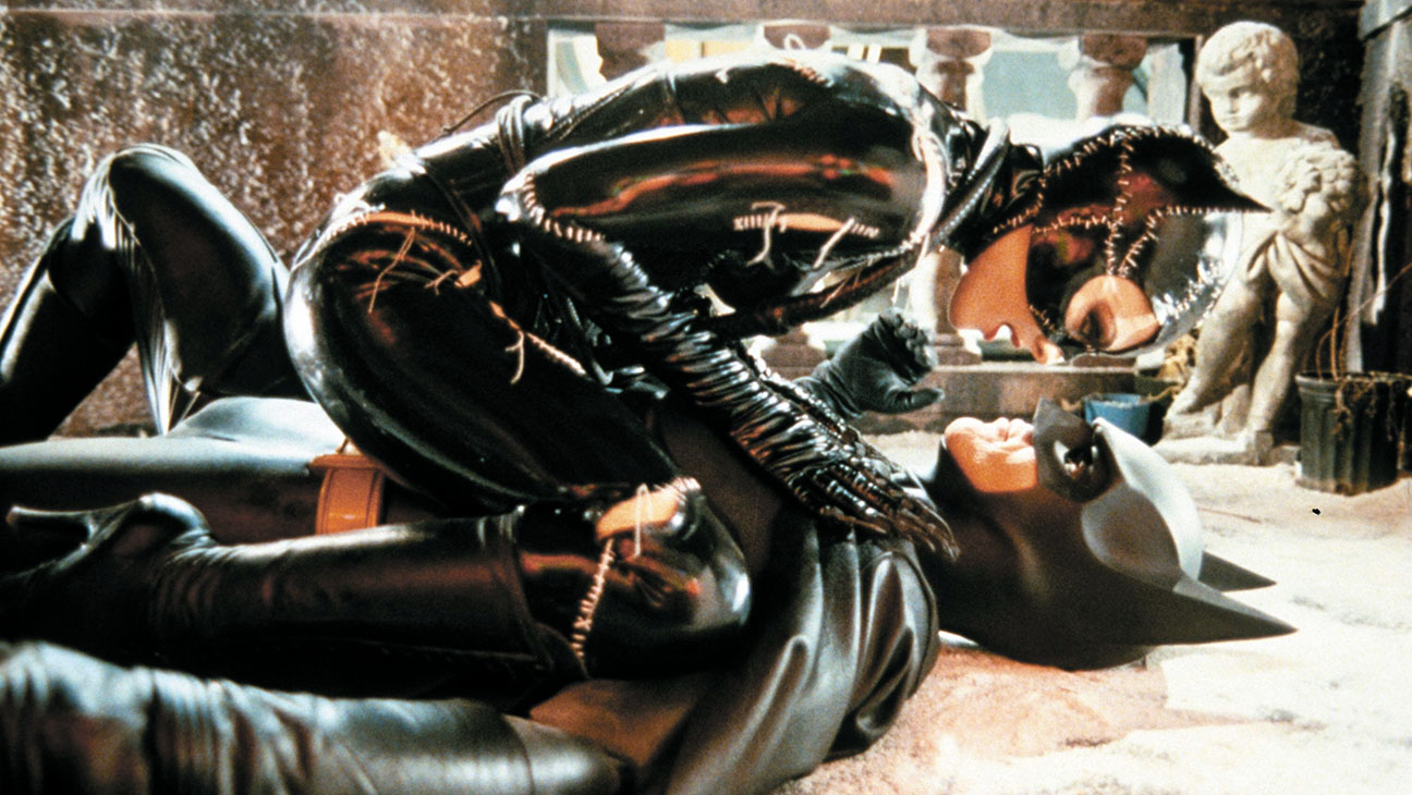 Batman Returns (1992) Directed by Tim Burton Shown: Michelle Pfeiffer (as Catwoman), Michael Keaton (as Batman)